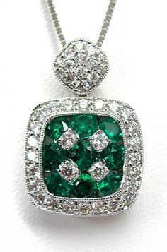 Ladies 18kt white gold gemstone and diamond pendant. Mounted in pendant are 9 brilliant round cut emeralds and 42 brilliant round cut diamonds. Pendant comes with a 18 inch white gold chain.