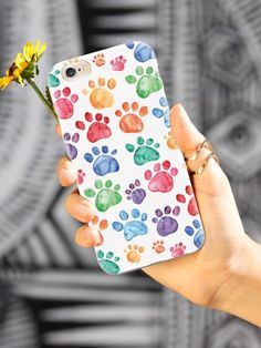 Give your iPhone 6 Plus & 6s Plus cell phone a unique style all its own. This Watercolor Paw Prints Case was professionally created and printed in the United States for all the pet owners out there! Textured printing raises parts of the images, creating a unique feel like no other case.  The case features high-quality, original design and images that not only set you apart, but keep your device protected - making it the perfect iPhone 6 Plus & 6s Plus accessory!