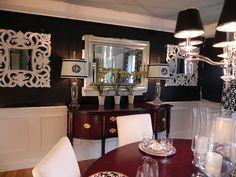 love the black walls & white framed mirrors
