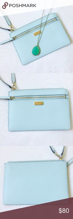 Kate Spade Newbury Lane Tinie Wristlet Only used once! Kate Spade New York saffiano leather wristlet and gold toned hardware Front zip pocket Wristlet strap is partially detachable for easy stowing and has a drop of approx. 6.5 inches Lined interior features 4 card slots Approx. dimensions: 7.5 in (L) x 5 in (H) x 0.25 in (W) Kate Spade Bags Clutches & Wristlets