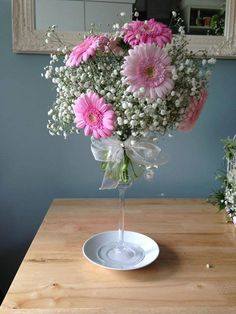 This beautiful display by Susie Green in Aberdeen is ideal for a feminine centrepiece with pink gysophila & germinia.