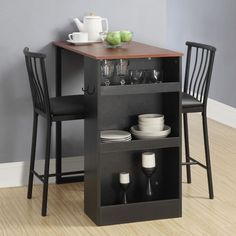 Features: -Built-in storage with 3 stationary shelves. -Set includes: 1 table and 2 padded chairs. -Weight limit is 225 lbs. Product Type: -Pub table set. Table Base Type: -Legs. Table Shape: -R