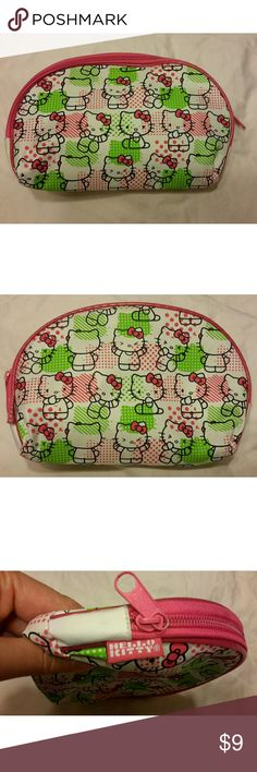Hello Kitty Cosmetic Bag Cite Hello Kitty Cosmetic Bag  EUC Measurements  Length 8.5 Height 5  Any questions, please ask.  30 % off Bundles of 2 or more items  Happy Poshing! Hello Kitty Bags Cosmetic Bags & Cases