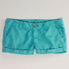 Sea green shorts.