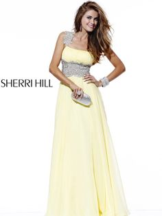 Gorgeous chiffon long prom dress Sherri Hill 1476. Single strap prom dresses look elegant injecting a sophisticated trend to prom events, homecoming social events, pageant competitions and even at wedding events. Intricate jewels embellish the single shoulder strap and the wide belt that wraps your tiny waist. The most delicate A-Line skirt drifts to the floor length in a graceful sweep train. Find this formal gown 2012 in Yellow, Lilac, Pink, Green Mint, Ivory and Aqua. Show stopping…
