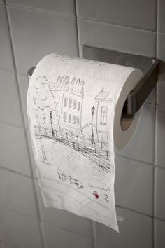 Printed toilet paper serves brand identity in the restroom of La Vache! by A Work of Substance