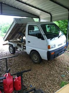 """1998 Suzuki Carry Mini Dump truck- got it in May 2013. I call it Rudy cuz"""" he's so small!!""""  60MPG w  A/C, stereo and right hand drive!"""