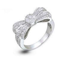 Bague or blanc 18ct et diamant. Anneau en forme de noeud, serti de 128 brillants