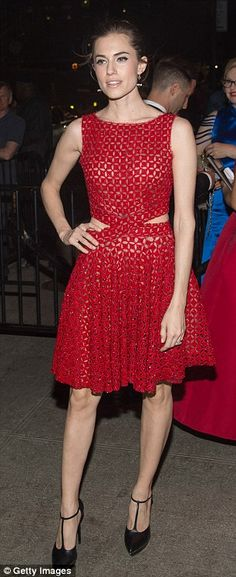 Cute cut-outs: Her scarlet skater dress boasted skin-baring nude panels at the waist...