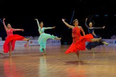 Women's linedance solo dancer's doing their number on the floor at the World Dancesport games 2013