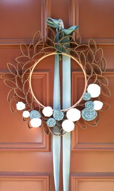 Toilet Paper TP tube roll wreath, would be great for Easter with egg shaped decorations, shown are no sew coiled fabric roses Excellent TUTORIAL