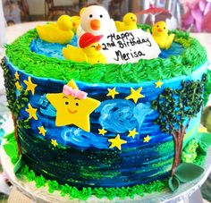A birthday cake with ducks and a pretty landscape! Cake # 122.