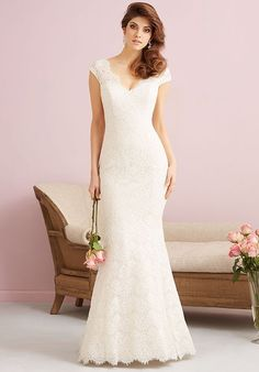 This lovely cotton lace gown proves that simple and chic bridal style is just as powerful as one bejeweled and glitzy.