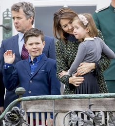 Crown Prince Frederik and Prince Christian looked dapper in their suits, whilst cheeky royal Princess Josephine was held by her mother