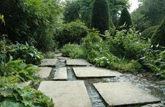 A rivulet flows through it - stone path combined with shallow, flowing water - A feature of Les Jardins Agapanthe, Normandy, France  {from The Garden Wanderer blog}
