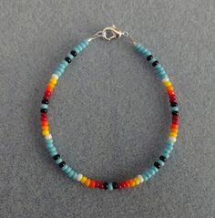 Blue Turquoise Beaded Bracelet. a well-made Native American made item as I take much pride in my work. in color Blue Turquoise and Sunburst Colors black, red, orange, yellow and white. I Also have the matching Necklace Listed. | eBay!