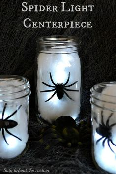 Crawly spiders are the center of attention in these mason jar Halloween lights. Great idea for a centerpiece. #HotelT2