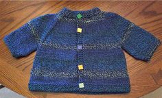 """From pattern: """"This is a seamless raglan cardigan knit from the top down. It measures a generous 20"""" around closed across the tummy and about 10"""" neck to bottom-about a 4 to 10 month size."""""""