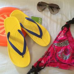 Flip flops 9 new New with tags. Perfect for the summer. Beautiful yellow- blue  Colorblock size 9 crocs Shoes Sandals