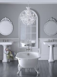 I'd do my bathroom like this except for the window style mirror and the light would be a dramatic colour like a pink or purple.