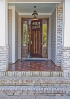 Acid stained Front Porch by Rock Solid Custom Concrete, Inc. in Wilmington, NC