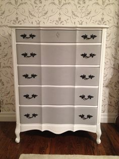 Painted in Annie Sloan Pure White and Paris Gray, spray-painted original hardware in black.