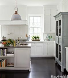 wood countertop gray and white cabinets