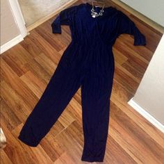 NWT Banana Republic Navy Surplice Jumpsuit NWT Banana Republic Navy Blue Surplice Jumpsuit. Made of 95% viscose and 5% elastane...so it's stretchy! Gorgeous! Just not my personal style after all. Has faux wrap front and tapered ankles so it'd look great with wedges or heels! Flattering fit! Could fit L-XL! Open to offers! Banana Republic Pants Jumpsuits & Rompers