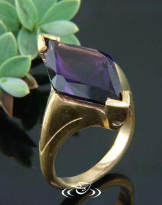 Custom 24kt yellow gold mounting to hold a chevron prong set custom cut diamond shaped dark purple amethyst (20x10x7mm).