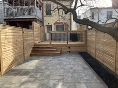 Total backyard transformation with pressure treated deck and fence, stone patio and landscape lights