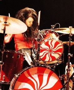 Meg White - while overshadowed, she held up her end pretty well, she's good, and can you imagine playing for years with your ex, how weird would that be?