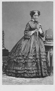 Civil War lady. Love the ruffles on her dress! The pattern I'm using looks like this dress.