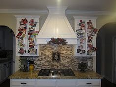 Christmas card display: cards clipped to ribbon taped to kitchen cabinet doors