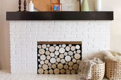 Play up an unused fireplace with this stacked log illusion.  We've got your instructions here. | thisoldhouse.com