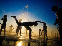 Israeli children play in the fountain in Tel Aviv, Israel
