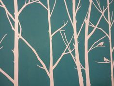 Reverse paint this on the bedroom wall in navy blue.   Tree and bird stencils for bedroom wall