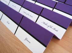 Manhattan Place Cards in purple and white and finished with black ribbon.