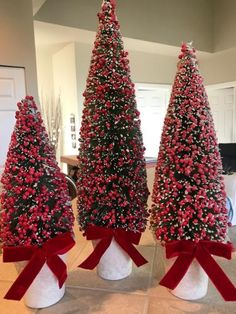 Oh, Christmas trees! Adorned with berries and accented with colorful ribbons, this set of bottlebrush trees will really put you in the holiday spirit. Tree Decorations, Christmas Decorations, Holiday Decor, Christmas Lights, Christmas Crafts, Christmas Tree Decorating Tips, Valerie Parr Hill, Potted Trees, Nutcracker Christmas