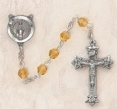 $28.74 + $9.25 shipping - Heritage Italian Catholic Topaz (November) Czech Birthstone Rosary Silver Oxidized 5mm Crystal Bead 1¼ Crucifix by Creed Jewelry, http://www.amazon.com/dp/B00CR6I2AK/ref=cm_sw_r_pi_dp_iXmKrb1J74NE9