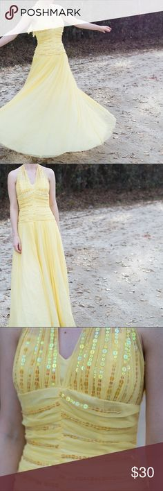 Yellow Tulle Halter Prom Dress Adorable tulle gown with sequins around the front.  The dress is sized as a 5/6, but fits like a 0, so that is that I\'m listing as.  I am 5\'4\