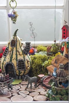 Ah! So cute!  A gourd house in a fairy garden.  Love the log slices for the floor, too.  This is the cutest thing ever!