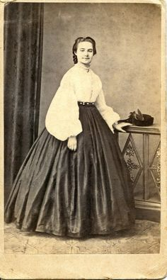 Smiling lady wearing white Italian Garibaldi style shirt | 1860's