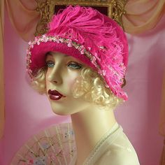 Adorable 1920's Vintage Style Floral & Feather Ribbonwork Cloche Flapper Hat by Patricia Josephine Antique Style Design.  This Beautiful Cloche Hat is made with a Vintage Dark Pink Hat Blank and is 22 1/2 inches in size with 15 1/2 inches over the crown.  The brim and crown are wrapped with a lovely pink and gold ribbonwork trim.  This hat is accented with a vintage curled pink feather and ombre millinery flowers with stamens and ribbonwork.   | eBay