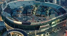 Somewhere in Japan is my guess. A baseball stadium converted to living quarters, complete with houses and parking.