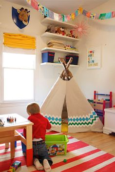DIY Play Teepee - LOVE!  They sell these bamboo sticks at Fred Meyer in the garden section for $2 each!  Then just get fabric