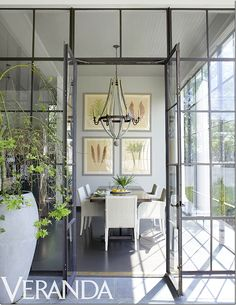 The breakfast room – love how it looks like it's in a glass box! Beadboard ceiling. Love the chandelier and the size of the prints – wonderful!