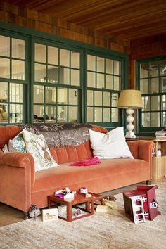 Family or Gathering room - love the orange   Country - Windowed living room with beadboard ceiling
