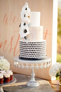 Very Cool Cake from: HeyThere-Cupcake.com -   Very Cool Wedding on #SMP here: http://www.StyleMePretty.com/2014/04/30/black-white-blush-seaside-wedding - Photography: AshleeRaubach.com