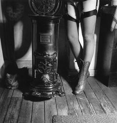 "Marcel Bovis (1904-1997), ""Legs with ankle boots and fishnet stockings, next to a stove"", 1941."