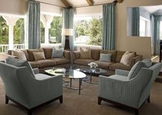 Soothing cocoa brown & aqua blue color scheme unifies living & dining areas. Note the same drapes used in living room w/ light brown walls & dining room w/ lighter blue walls|.....I like this color idea for our bedroom by thelma